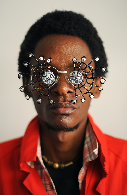 "Cyrus Kabiru, ""Carribean Sun"" photograph series of a person wearing unique glasses"