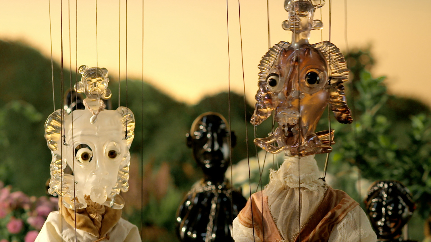 Image still from video of puppets on strings.
