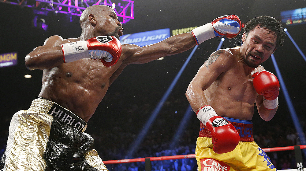 Floyd Mayweather golpeia Manny Pacquiao (AP Photo/John Locher)
