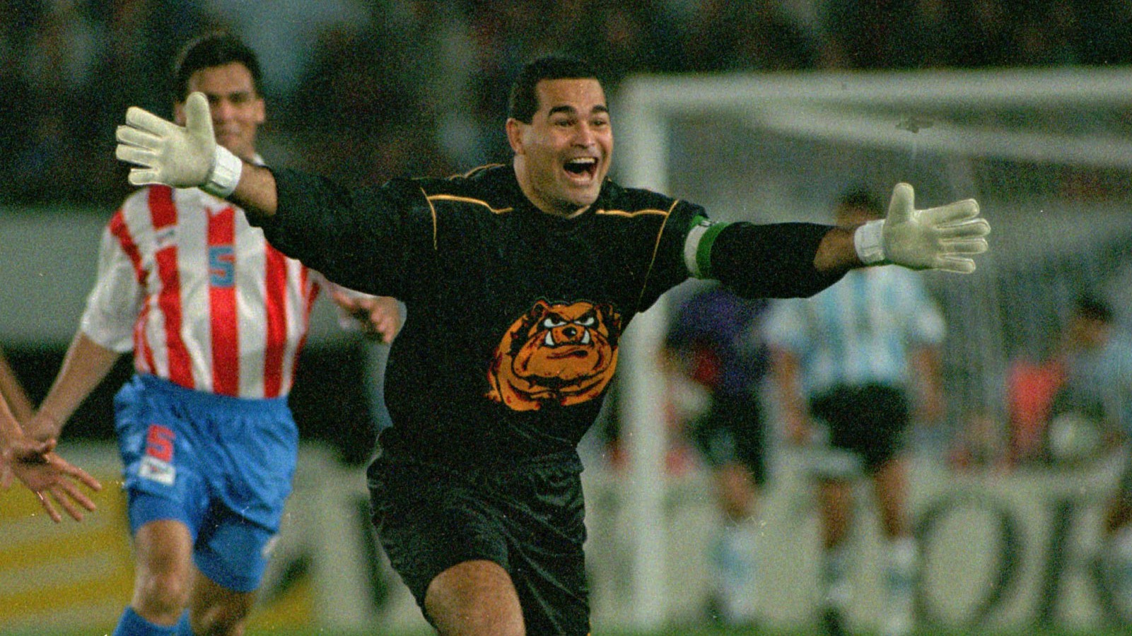 Paraguayan goalkeeper Jose Luis Chilavert running jubilant after marking his goal during qualifying match for France 98 play in Buenos Aires Sunday Sept.1,1996. Argentina and paraguay tied 1-1.(AP Photo/Daniel Muzio)