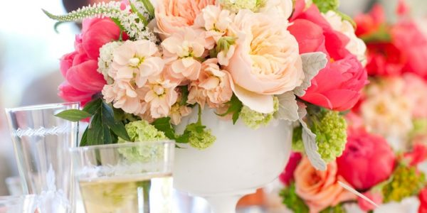 Use milk glass vases with white linens to create a monochromatic design for your chic reception tables