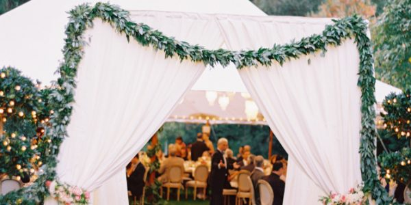 Tent weddings are no longer solely associated with a casual backyard bash