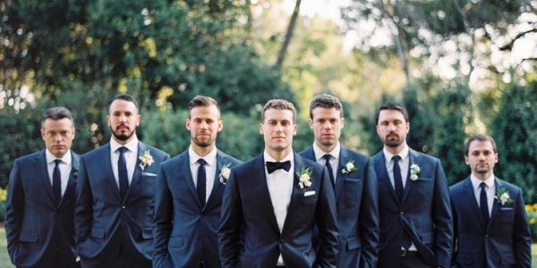 Traditionally, the groomsmen wear attire that's the same as or similar to that of the groom