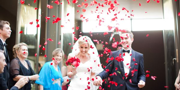 By swapping out colorful paper for white rose petals, celebrity wedding planner Mindy Weiss gave the confetti cannon a seriously romantic update for a ceremony
