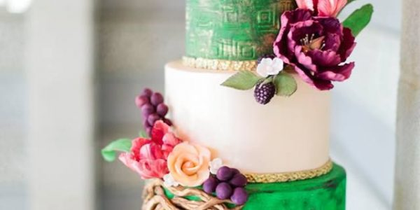 Cakes with more vibrant, daring, and moody color schemes will be all the rage