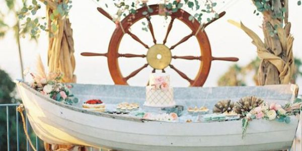 This rowboat doubles as a ceremony backdrop and a photo booth for the reception