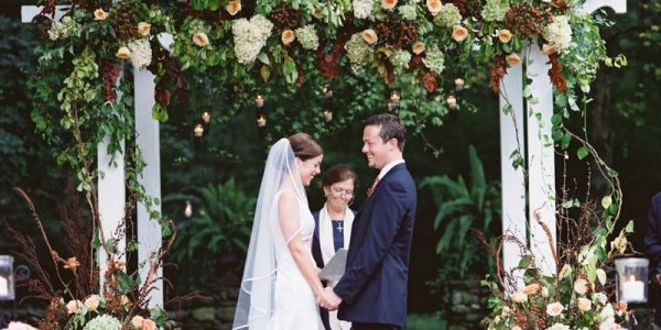 If you're looking for the right backdrop to your outdoor ceremony space, try a macrame curtain