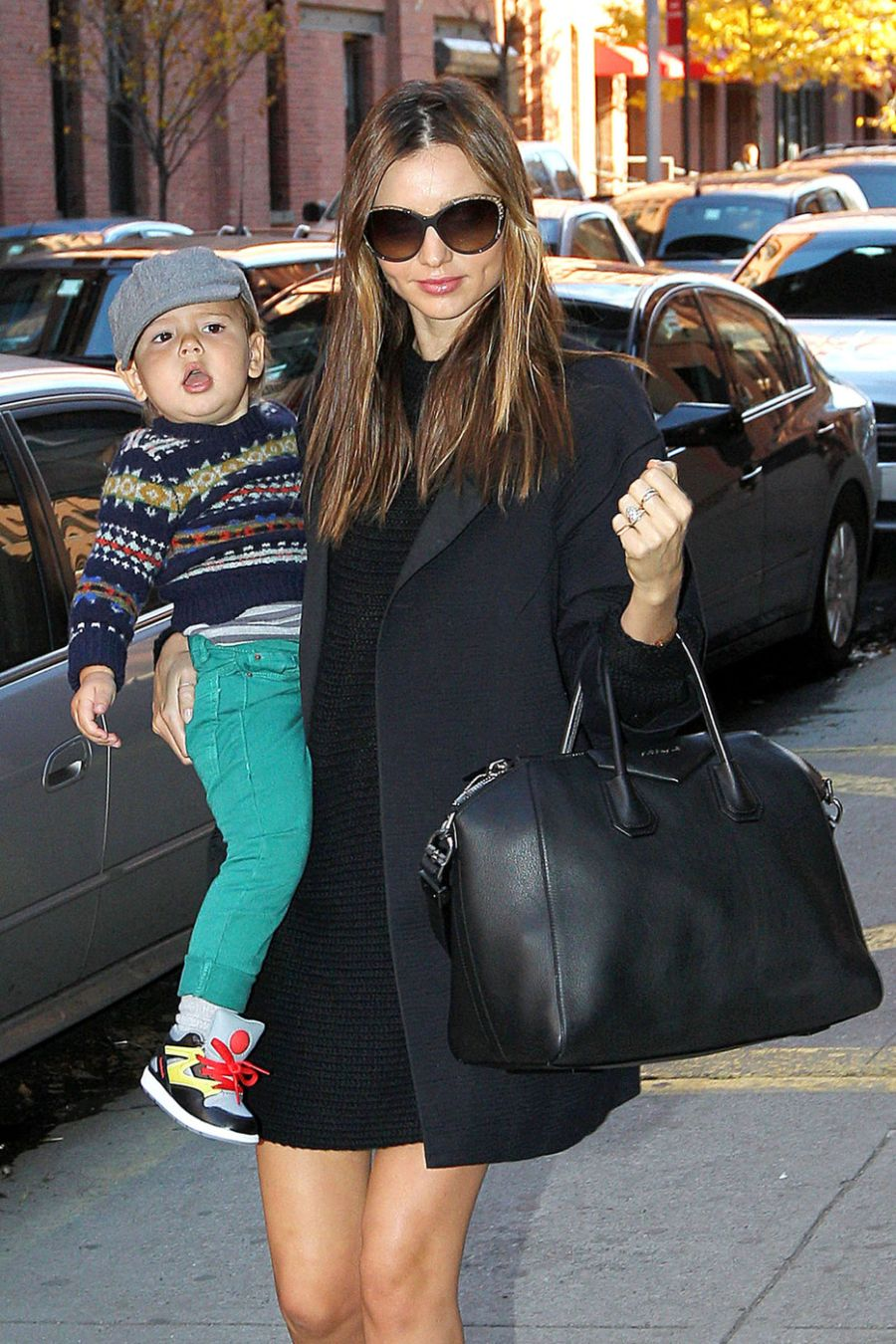 Miranda Kerr holds onto her adorable son Flynn as the mother/son duo are spotted out and about in the Meatpacking District, New York City