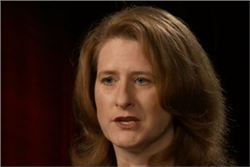 Alicia Aiken, The Confidentiality Institute: woman with shoulder length red hair, speaking