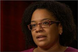 Juanita Davis, NCALL: woman wearing eyeglasses, short curly hair, speaking