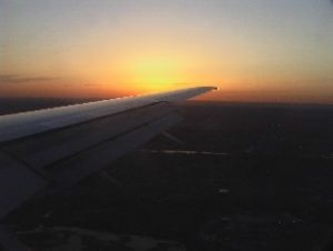 Sun setting from plane