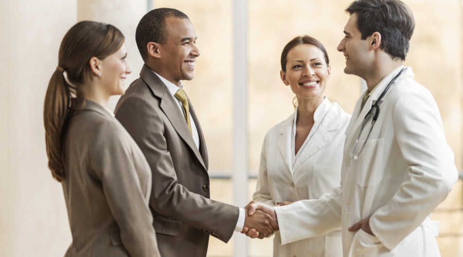 Business people collaborating with doctors. African American businessman shaking hands with a male doctor. [url=http://www.istockphoto.com/search/lightbox/9786662][img]http://dl.dropbox.com/u/40117171/medicine.jpg[/img][/url] [url=http://www.istockphoto.com/search/lightbox/9786622][img]http://dl.dropbox.com/u/40117171/business.jpg[/img][/url]