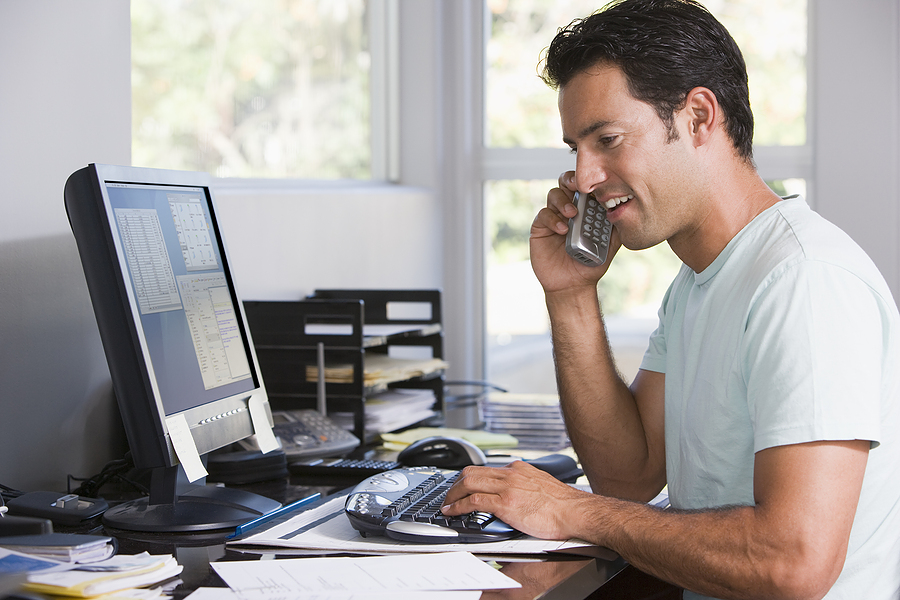 Bigstock Man In Home Office On Telephon 4133311