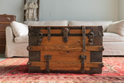 Wedding furniture slip covered chair and vintage trunk