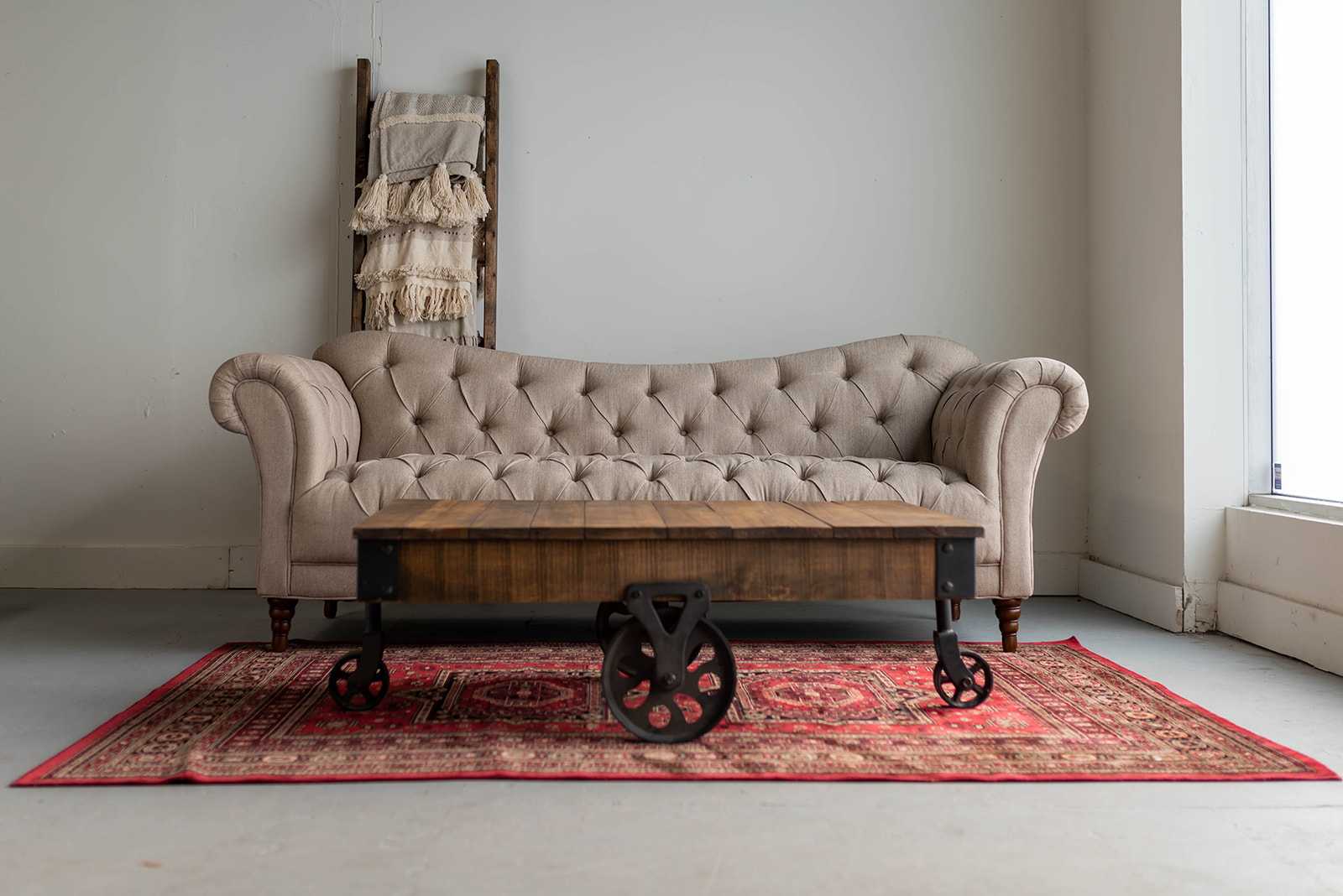 Tufted sofa with rolled arms