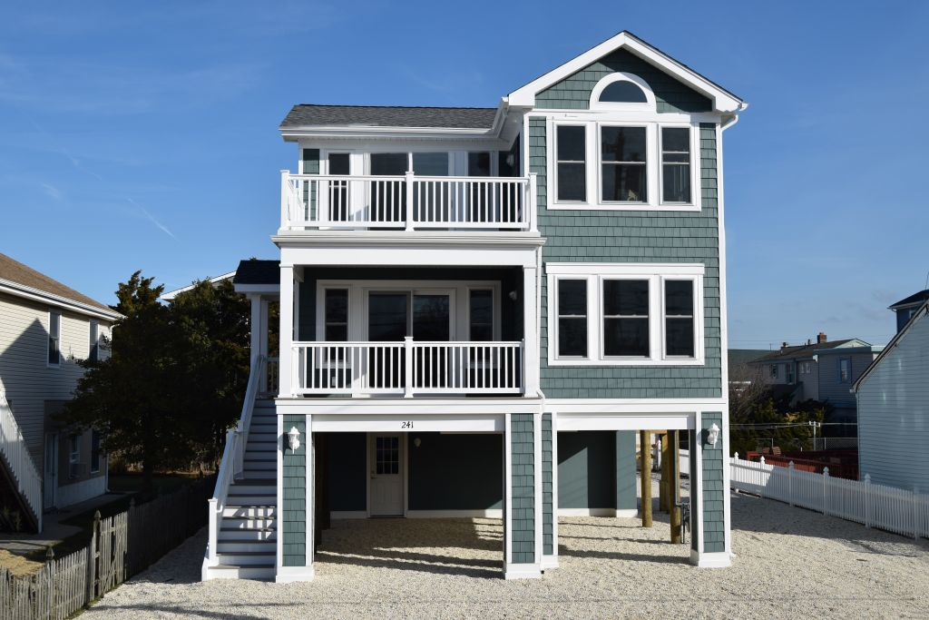 Why we build reverse living custom home designs on lbi for Reverse living house plans