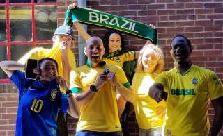 Brazil fans happy to win against Mexico 2-0 to advance.