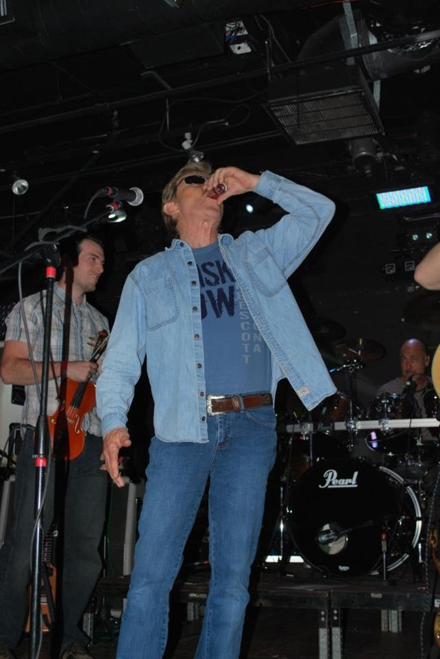 Untitled 10-31-2018 - Taking a shot of whiskey at the start of our live show at Club Red, before singing the tune Whiskey Row.