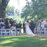 Wide shot of a wedding ceremony at Apple Holler