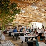 Wide view of a barn wedding reception at Apple Holler