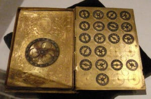 16th-century French cypher machine in the shape of a book with the arms of Henry II