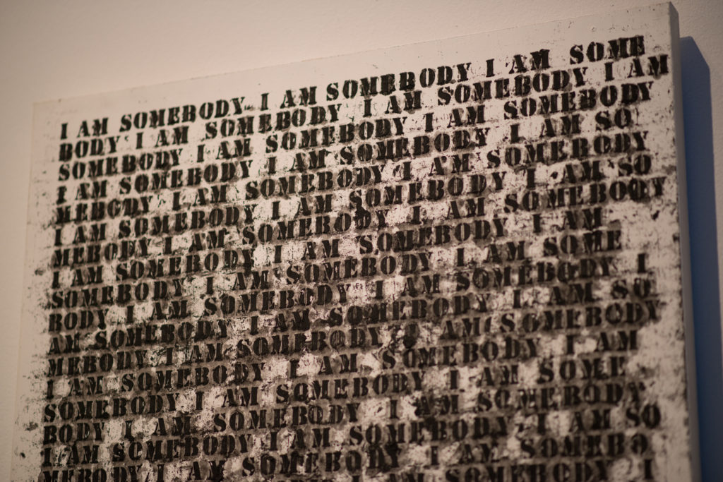 """Oil stick, gesso, and graphite on wood artwork by Glenn Ligon, """"Untitled (I am Somebody)"""", it reads """"I am somebody"""" repeatedly"""