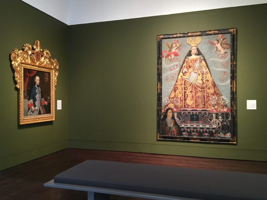 Corner of the Art of the Spanish Americas Gallery at the Blanton Museum of Art, two paintings are displayed on the walls