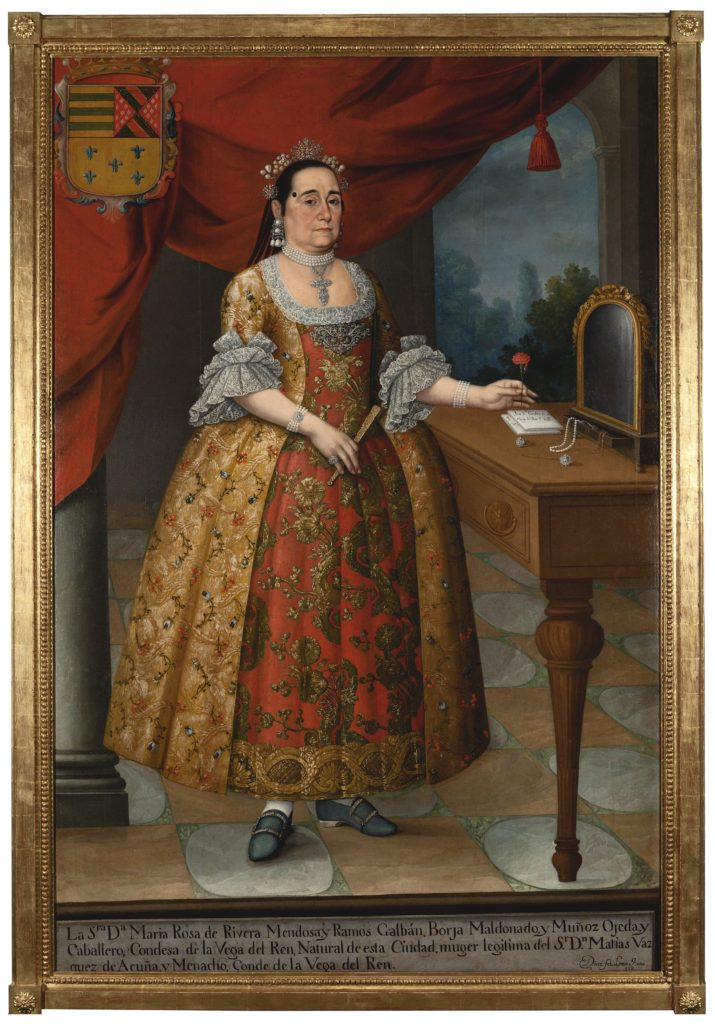 An oil painting portrait of Doña María Rosade Rivera Countess of Vega del Ren. She stands next to a small table while holding a flower in her left hand and a folding fan in her right hand