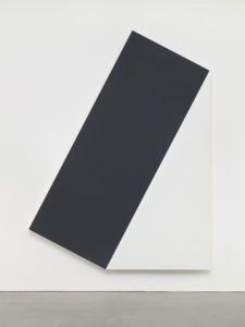 """Ellsworth Kelly, """"Dark Gray with White Triangle I,"""" 1977, oil on canvas, two joined panels, 122 1/2 x 93 1/2 inches (311.2 x 237.5 cm). ©️Ellsworth Kelly Foundation. Photo Ron Amstutz, courtesy of Ellsworth Kelly Studio"""