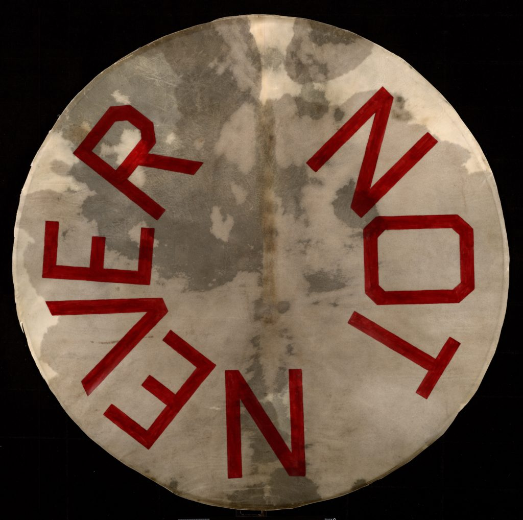 """Artwork by Ed Ruscha, a drumskin head with """"Not Never"""" painted on it"""