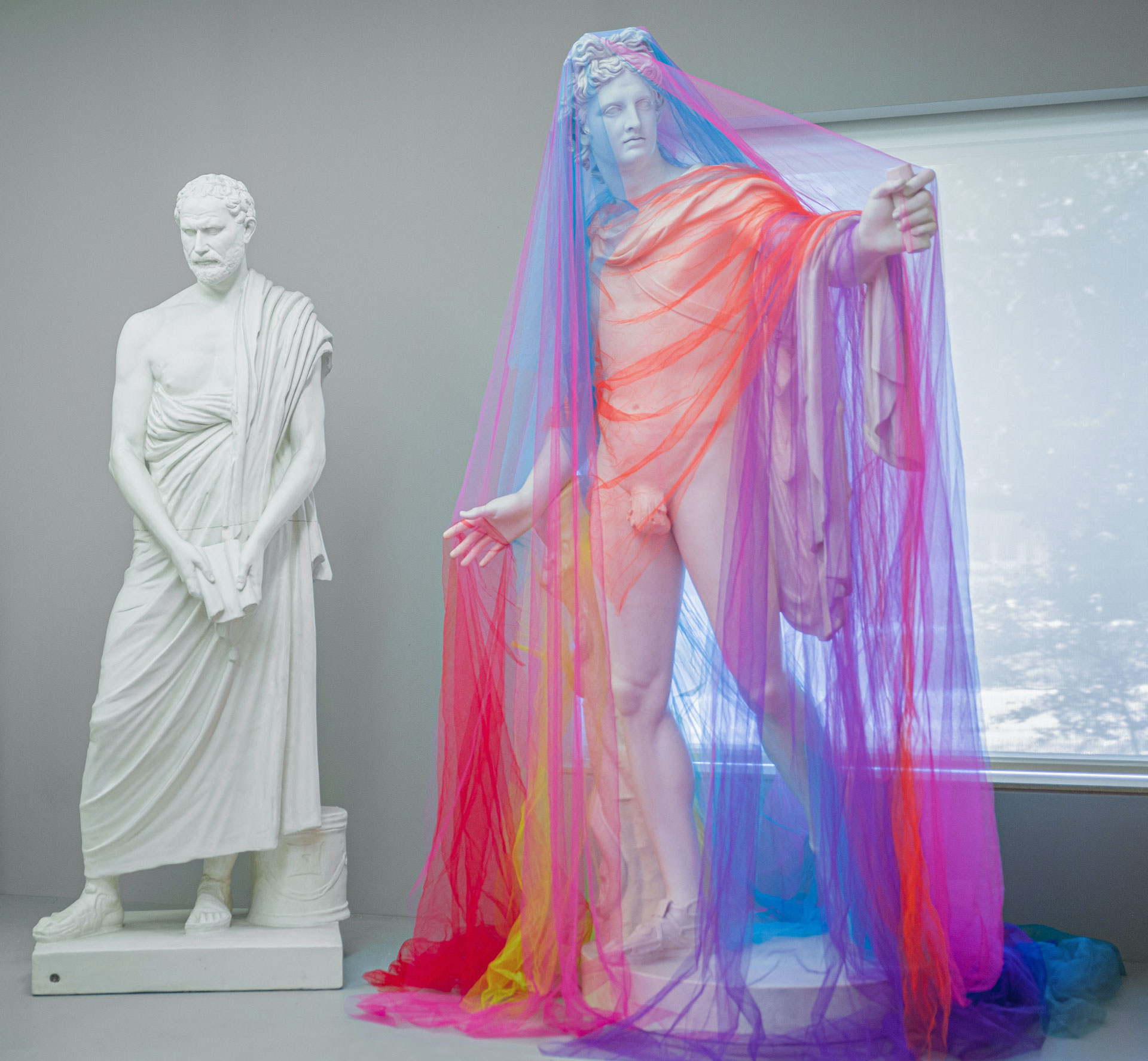 Lily Cox-Richard, intervention in the Osborne Seminar Room, synthetic tulle netting and Apollo Belvedere, 19th-century reproduction, plaster cast from Roman adaptation or copy of a Greek bronze original by Leochares (circa 330 BCE), The William J. Battle Collection of Plaster Casts. Photo by Manny Alcalá.