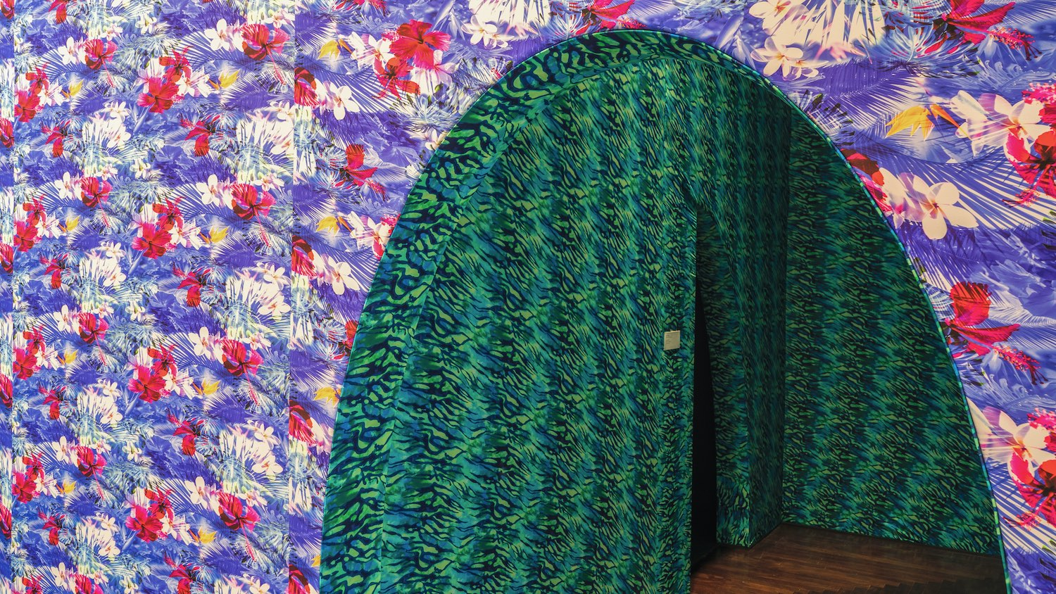 "Installation view of ""Joiri Minaya: Labadee"" featuringthe colorful wall coverings and entryway at the Blanton Museum of Art, The University of Texas at Austin, September 14–December 8, 2019. Photo by Manny Alcalá."