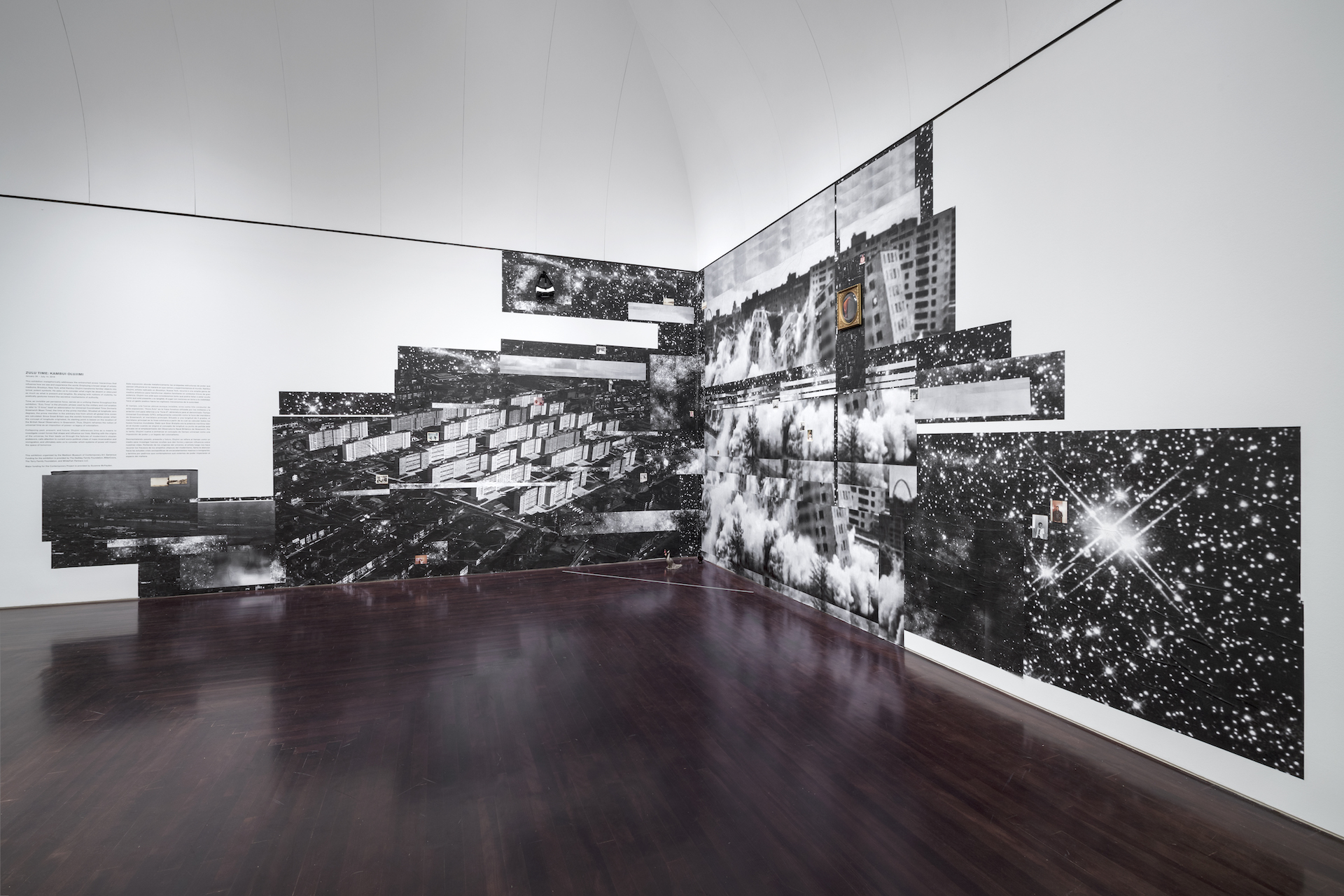 """View of the installation """"The Black That Birthed Us/Ville Radieuse, habite-à-machine (The Radiant City, the living machine), Mash Up #2"""" by Kambui Olujimi at the Blanton Museum"""