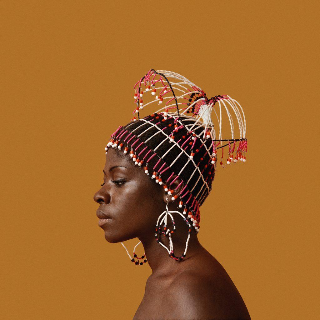 Kwame Brathwaite, Sikolo Brathwaite wearing a headpiece designed by Carolee Prince, African Jazz-Art Society & Studios (AJASS), Harlem, circa 1968 (detail); from Kwame Brathwaite: Black Is Beautiful (Aperture, 2019), Courtesy the artist and Philip Martin Gallery, Los Angeles
