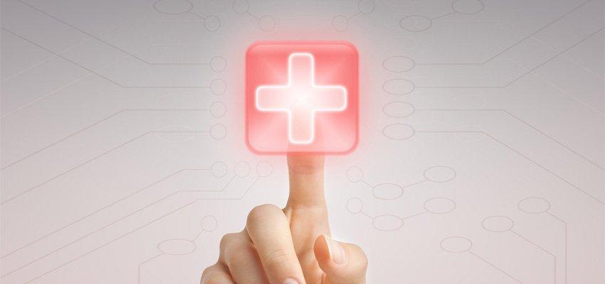 dedo apertando botão vermelho com cruz branca