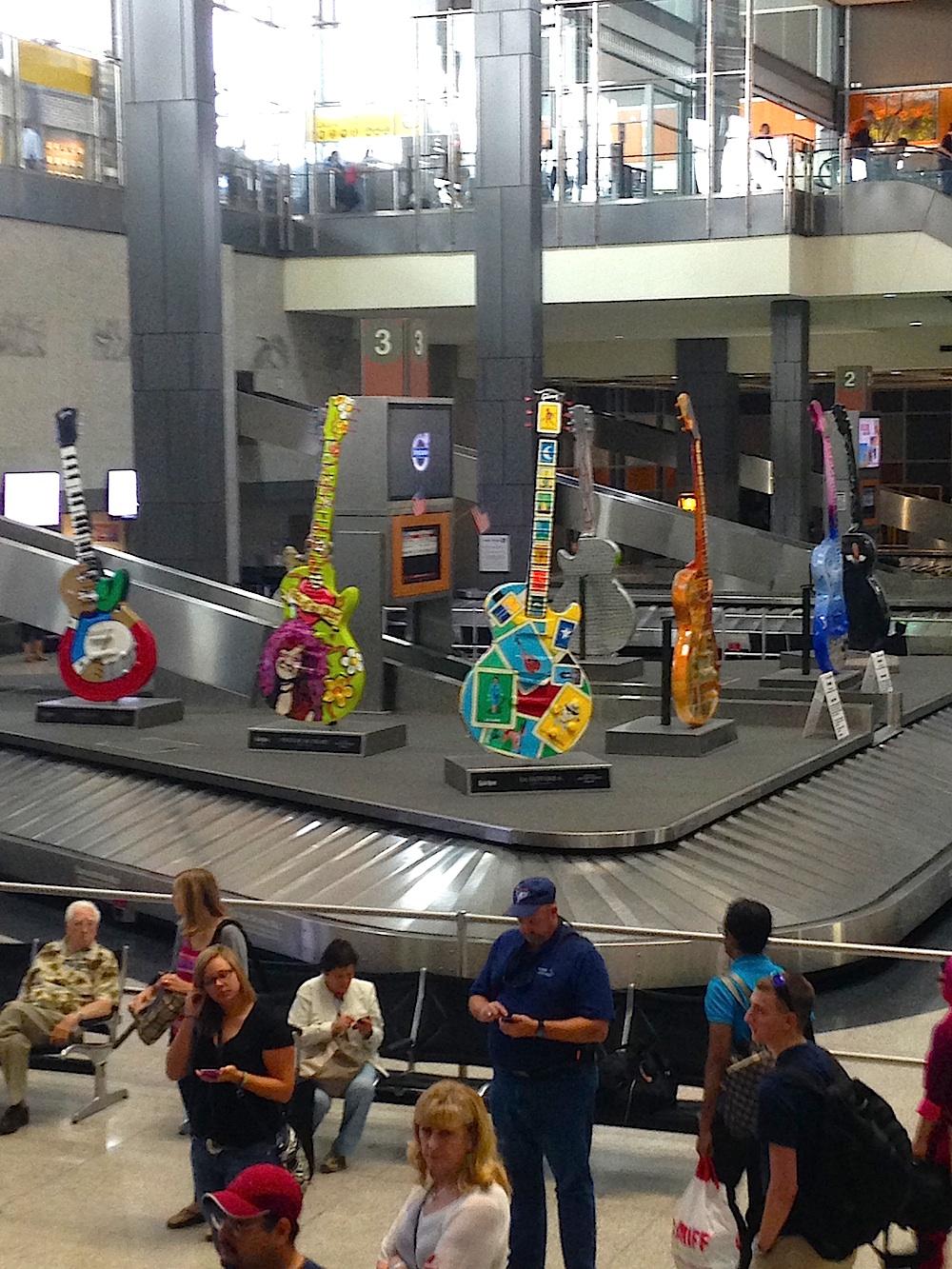 Guitar art near the baggage claim. Photo courtesy of Ally Marotti.