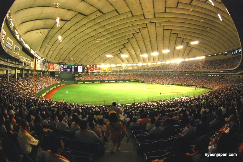 A baseball game at Tokyo Dome, where international baseball fans flock to see someone steal home.