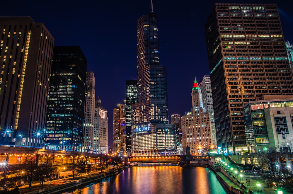 The lit-up, nighttime skyline of Chicago, which is one of the best Labor Day getaways of 2016.