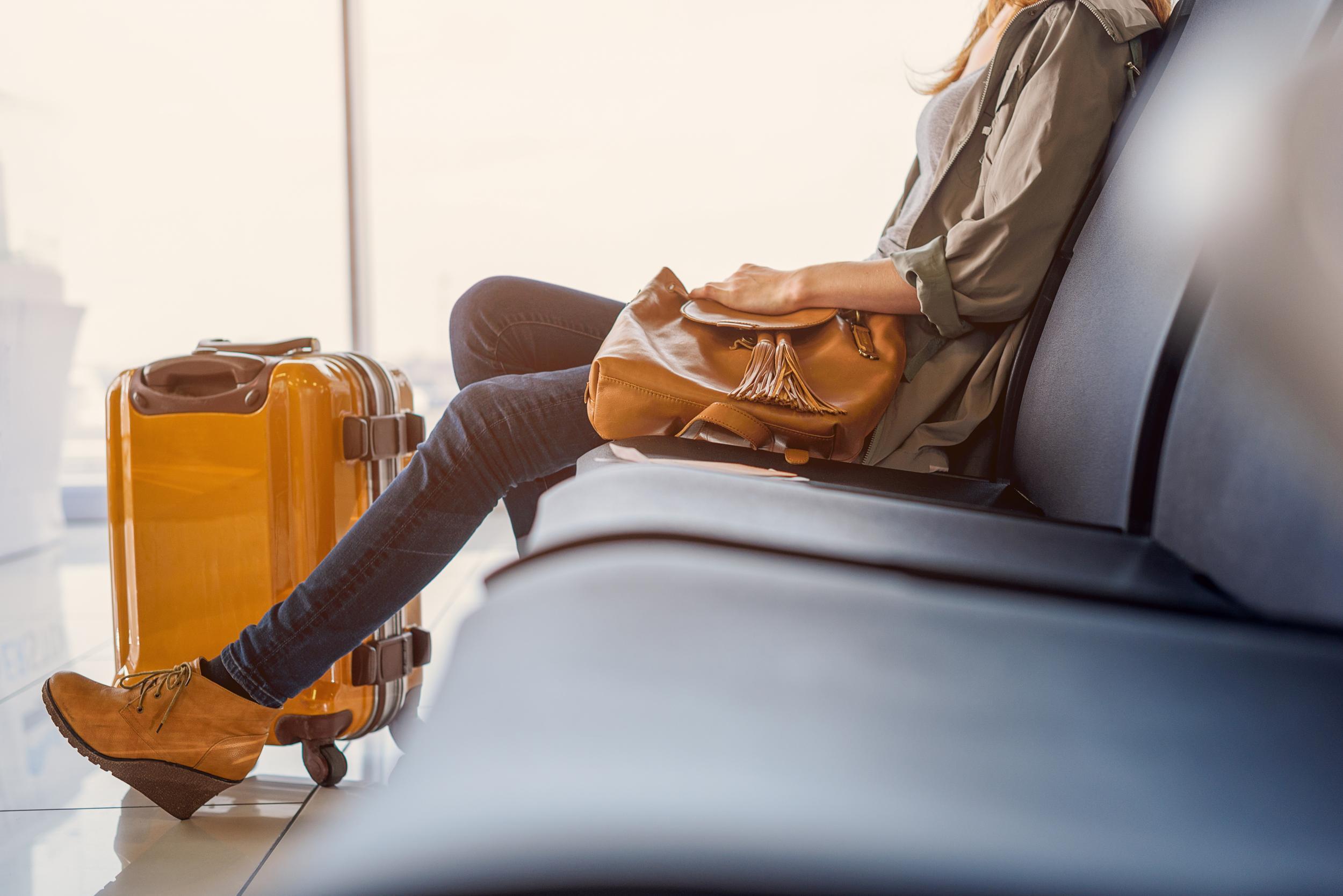 Smiling girl waiting for boarding