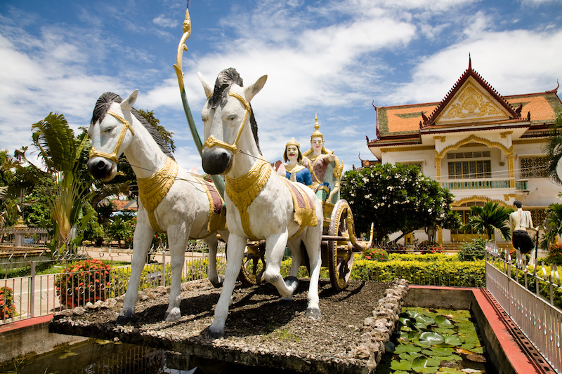 Statues in front of a Cambodian buddhist temple called Wat Kampheng in the city of Battambang