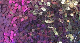 pile of coins with colored lights