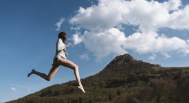 young woman jumping in nature