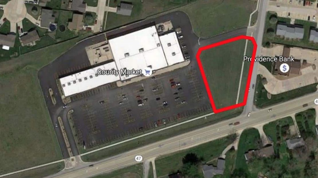 Ariel photo of Winfield Plaza with Outlot B outlined in red.