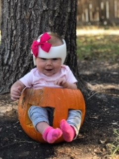 Image of Cora in a carved pumpkin.