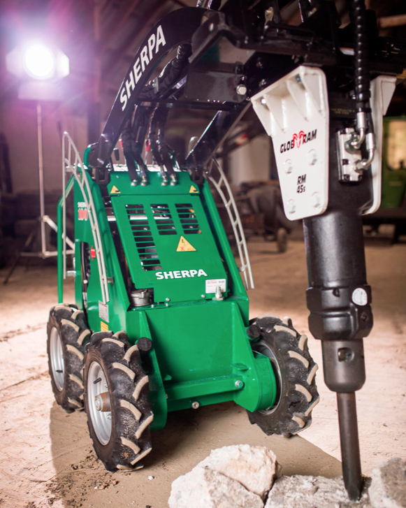 The Sherpa 100ECO with Hydraulic Hammer Attachment Working Indoors