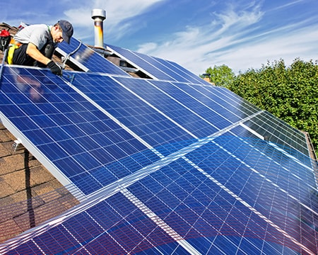 Technician in the Roof Fixing Solar Pannels