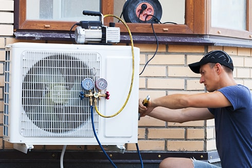 A technician replacing an A/C