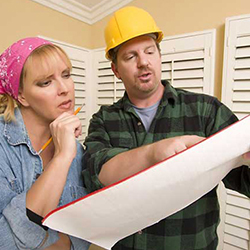 A homeowner and contractor talking about maintenance agreements