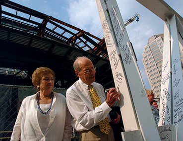 Dr. Benjamin & Marian Schuster signing a steel beam during construction of the Schuster Center