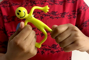 Hands of child playing with a bending toy